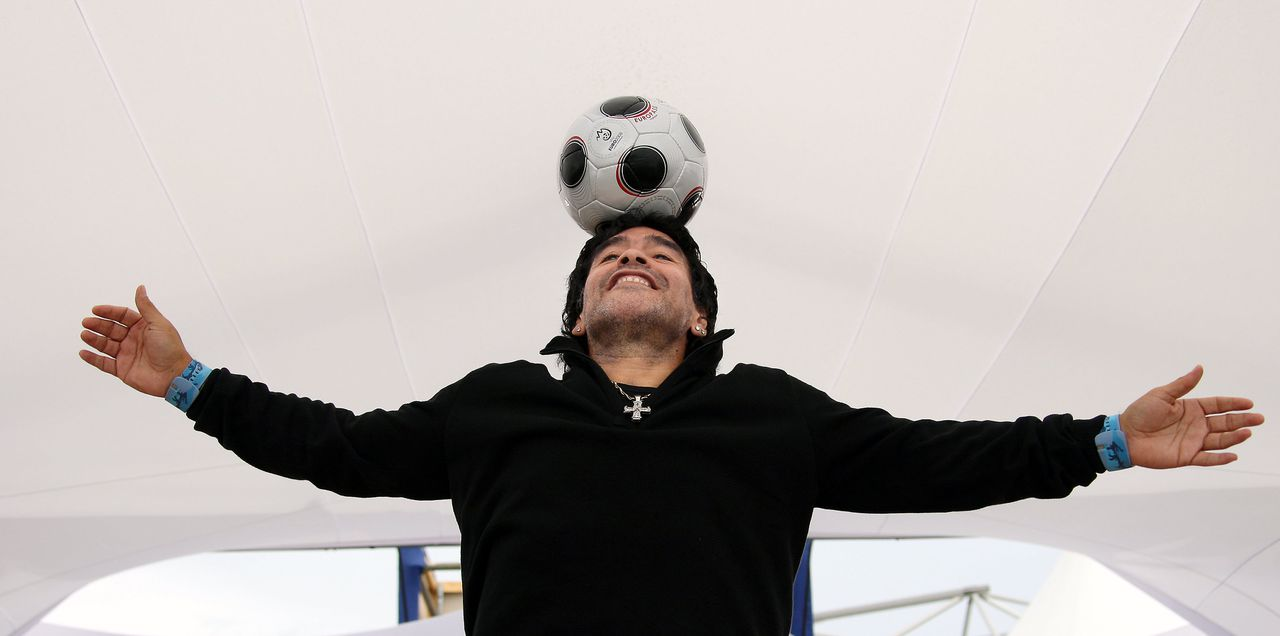 Diego Maradona (FILES) Former Argentinian football player Diego Maradona controls the ball as he poses during a photocall for Serbian director Emir Kusturica's film 'Maradona by Kusturica' at the 61st Cannes International Film Festival on May 20, 2008 in Cannes, southern France. Argentinian football legend Diego Maradona was named coach of the national team on October 28, 2008 in Buenos Aires, according to 1986 World Cup winning coach Carlos Bilardo, after he came out of a meeting with Argentinian Football Association president Julio Grondona. AFP PHOTO / Valery Hache