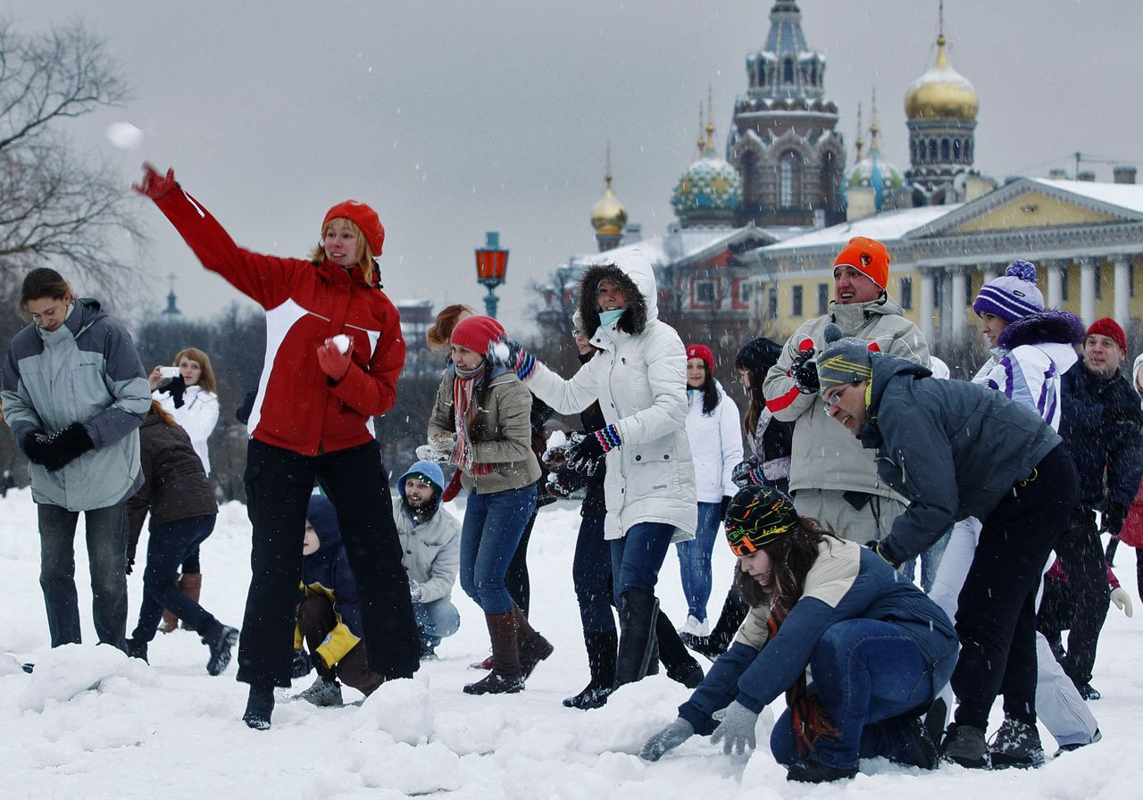 People play at snowballs during a snowball fight flashmob in St.Petersburg, Russia, Saturday, Jan. 14, 2012. (AP Photo/Dmitry Lovetsky)