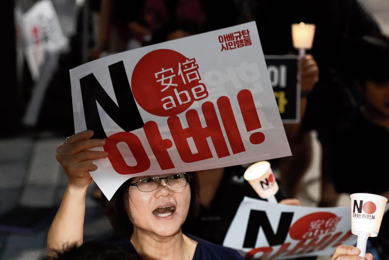 "A South Korean protester reacts during a rally about the General Security of Military Information Agreement, or GSOMIA, in front of Japanese embassy in Seoul, South Korea, Thursday, Aug. 22, 2019. South Korea will stop exchanging classified intelligence on North Korea with Japan amid a bitter trade dispute, an official said Thursday, a surprise announcement that is likely to set back U.S. efforts to bolster security cooperation with two of its most important allies in the Asian region. The sign read ""No Abe."" (AP Photo/Lee Jin-man)"