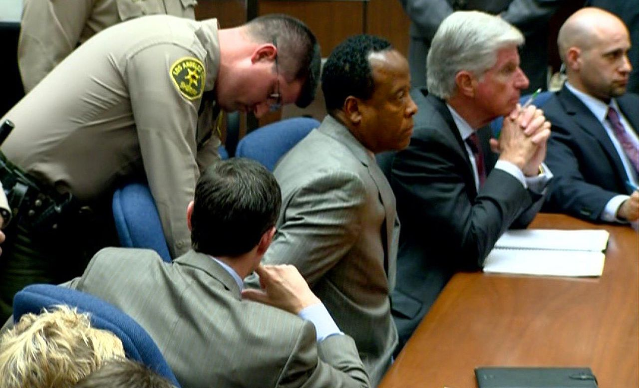 Dr. Conrad Murray is remanded into custody after the jury returned with a guilty verdict in his involuntary manslaughter trial Monday, November 7, 2011 in a Los Angeles courtroom. Murray was convicted in the 2009 death of pop singer Michael Jackson from an overdose of the powerful anesthetic propofol. AFP PHOTO / TV POOL FRAME GRAB