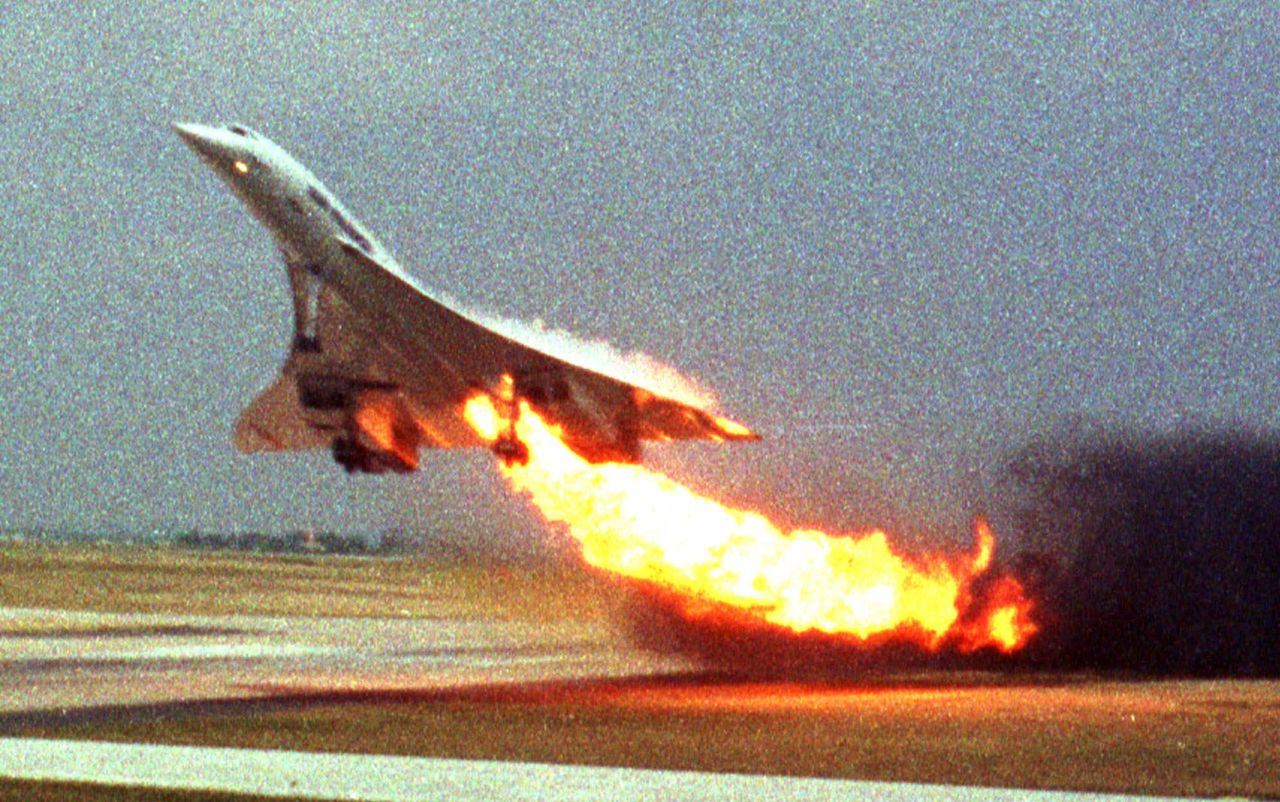 FILE - Air France Concorde flight 4590 takes off with fire trailing from its engine on the left wing from Charles de Gaulle airport in Paris, in this July 25, 2000 file photo. The plane crashed shortly after take-off, killing all the 109 people aboard and four others on the ground. For nearly a decade, investigators have argued that the jet never would have crashed if a Continental Airlines DC-10 hadn't dropped a piece of titanium onto the runway minutes before the supersonic craft took off. That finding will go up for debate as a long-awaited trial on the crash finally starts Tuesday Feb. 2 2010 after a decade of probes. (AP Photo/Toshihiko Sato, File) MANDATORY CREDIT PHOTOGRAPHER TOSHIHIKO SATO ** JAPAN OUT **