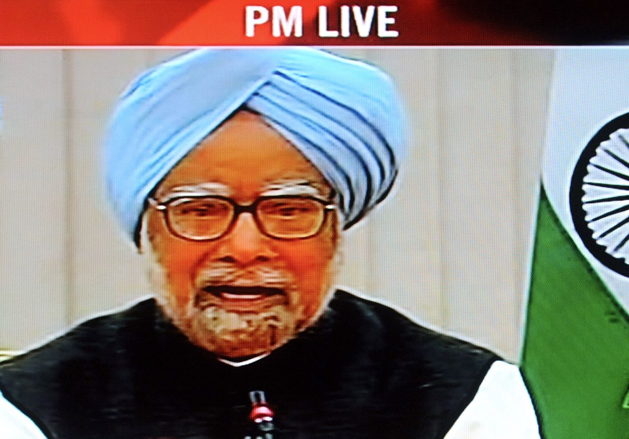 """In this TV Grab picture taken from India's Dhoordarshan TV channel on February 16, 2011 Indian Prime Minister Manmohan Singh addresses a press conference at his residence in New Delhi. Manmohan Singh denied he had ever considered stepping down as his government recently suffered a series of setbacks and public corruption scandals. RESTRICTED TO EDITORIAL USE - MANDATORY CREDIT - """"AFP PHOTO/DOORDHARSHAN/TV GRAB/RAVEENDRAN"""" - RESTRICTED TO EDITORIAL USE - DISTRIBUTED AS A SERVICE TO CLIENTS -"""