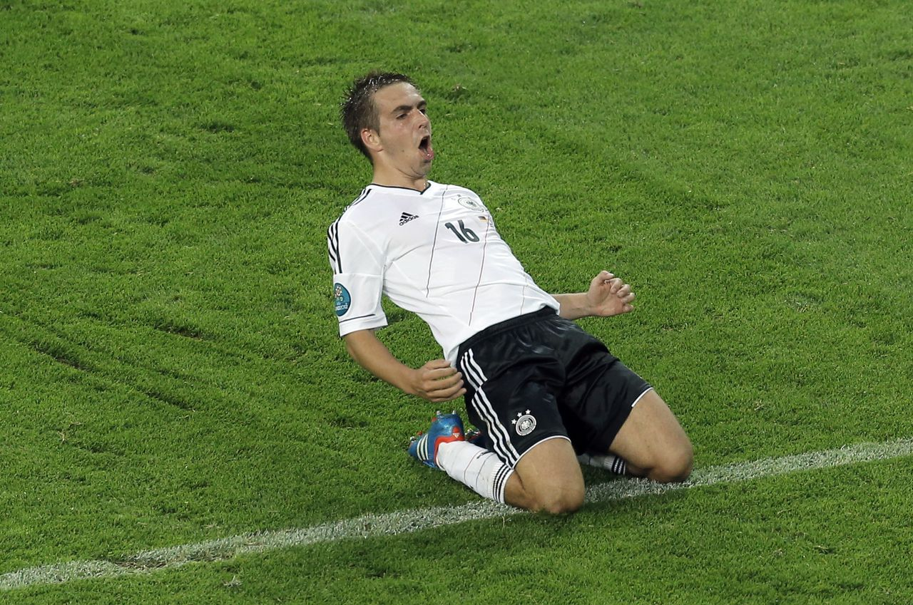 Germany's Philipp Lahm celebrates scoring the opening goal during the Euro 2012 soccer championship quarterfinal match between Germany and Greece in Gdansk, Poland, Friday, June 22, 2012. (AP Photo/Gero Breloer)