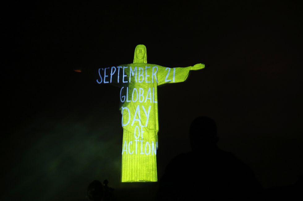 The statue of Christ the Redeemer is lit up with a message announcing a global mobilisation for climate, in Rio de Janeiro