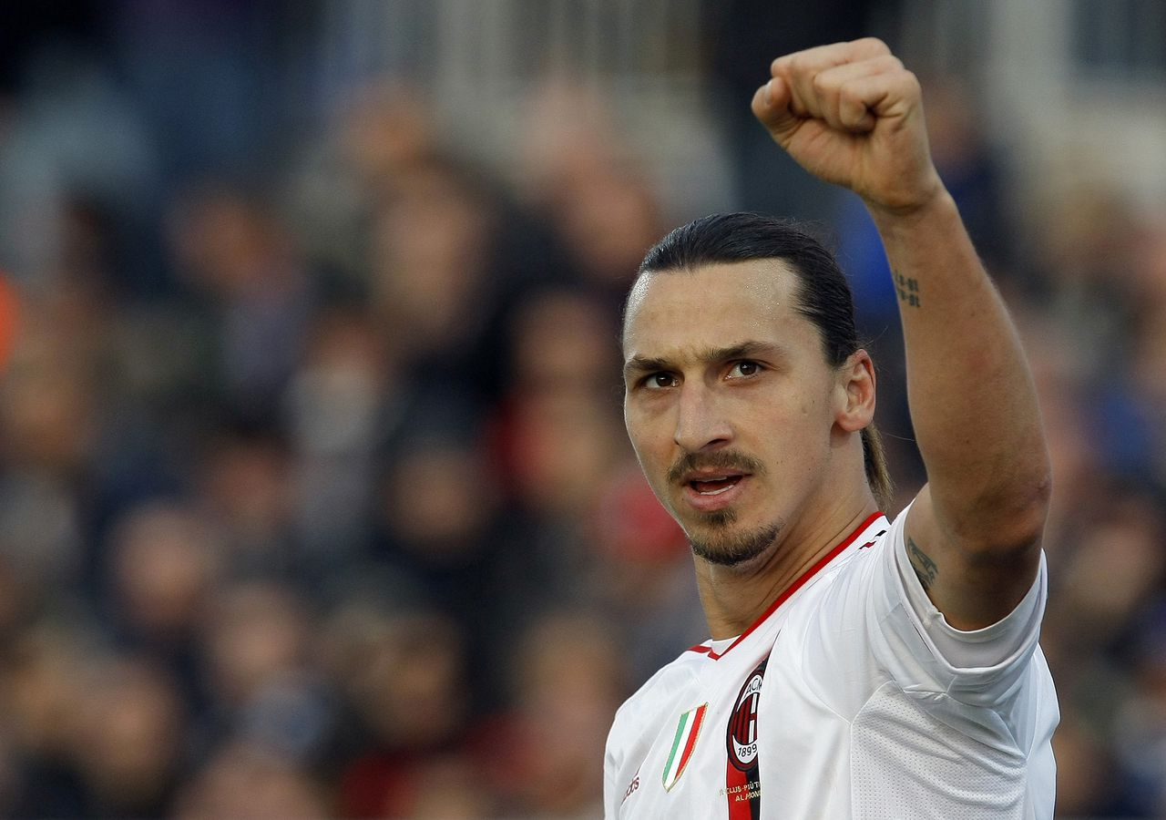 AC Milan's Zlatan Ibrahimovic celebrates after scoring against Novara during their Italian Serie A soccer match at the Piola stadium in Novara January 22, 2012. REUTERS/Alessandro Garofalo (ITALY - Tags: SPORT SOCCER)