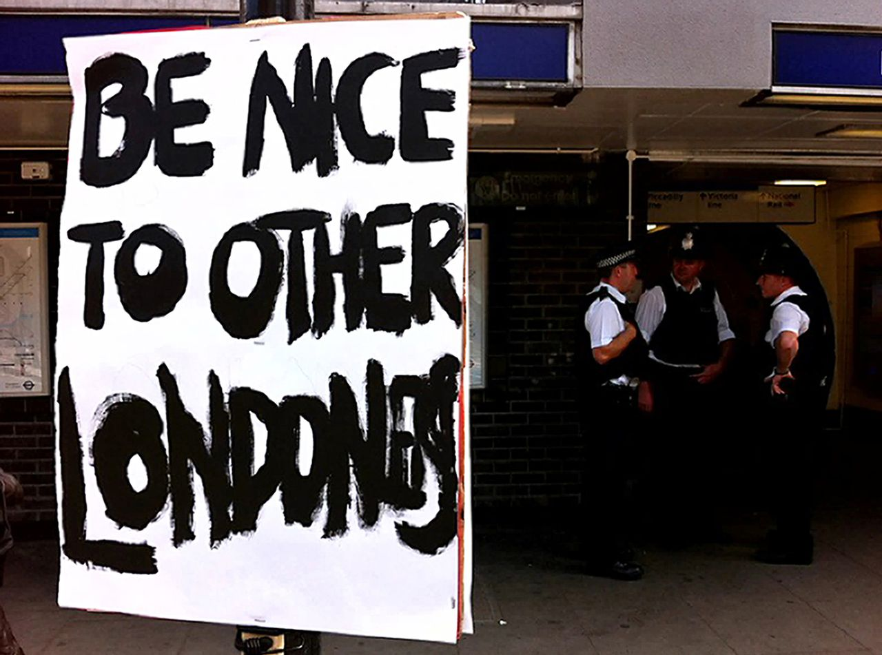 A sign urging Londoner's to be nice to each other is pictured near an underground station in north London, on August 10, 2011, following a fourth night of violence in Britain. Britain's worst riots in decades raged into Wednesday as youths ran amok in Manchester and the industrial Midlands but London was quiet with 16,000 police swamping the streets to stem violence. AFP PHOTO/LEON NEAL