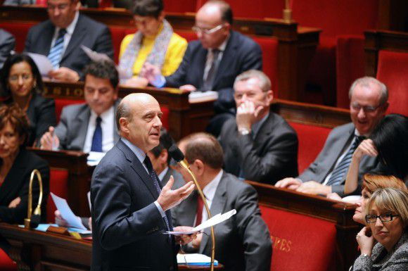 French Foreign Affairs Minister Alain Juppe speaks during the weekly session of questions to the government, on December 13, 2011 at French National Assembly in Paris. AFP PHOTO / MARTIN BUREAU