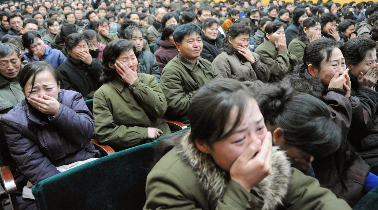 Pyongyang residents react as they mourn over the death of North Korean leader Kim Jong-il in Pyongyang, in this photo taken by Kyodo on December 19, 2011. Kim Jong-il died on a train trip on Saturday, state television reported on Monday, sparking immediate concern over who is in control of the reclusive state and its nuclear programme. Mandatory Credit REUTERS/Kyodo (JAPAN - Tags: POLITICS OBITUARY) FOR EDITORIAL USE ONLY. NOT FOR SALE FOR MARKETING OR ADVERTISING CAMPAIGNS. THIS IMAGE HAS BEEN SUPPLIED BY A THIRD PARTY. IT IS DISTRIBUTED, EXACTLY AS RECEIVED BY REUTERS, AS A SERVICE TO CLIENTS. MANDATORY CREDIT. JAPAN OUT. NO COMMERCIAL OR EDITORIAL SALES IN JAPAN. YES