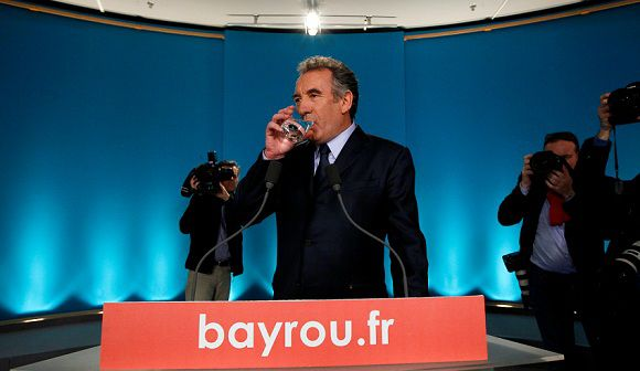 Caption: French Centrist Democratic Movement Modem party and candidate for the 2012 presidential elections, Francois Bayrou drinks a glass of water prior to deliver his statement during a press conference in Paris, France, Thursday, May, 3, 2012. Bayrou said he would not give his voters specific guidance for Sunday's vote but that he will cast a ballot for Socialist candidate Francois Hollande, in a blow to conservative President Nicolas Sarkozy. (AP Photo/Francois Mori)