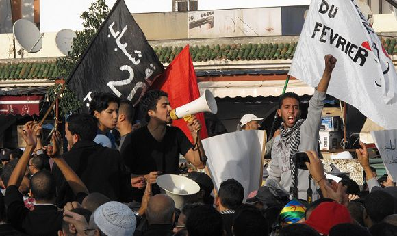 Caption: Activists from Morocco's February 20 movement chant slogans during a demonstration by some thousands in the Bournazeel working class neighborhood of Casablanca on Sunday Nov. 13, 2011. Pro-democracy activists in this North African kingdom are calling for a boycott of the Nov. 25 elections saying they will be rigged and have no real meaning. (AP Photo/Paul Schemm)