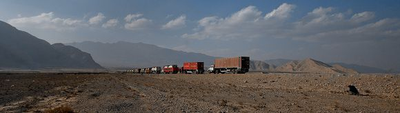 Caption: Trucks, including those carrying supplies to NATO forces in Afghanistan, line up in the outskirts of Quetta after the Chaman border crossing was closed to traffic November 26, 2011. REUTERS/Naseer Ahmed (PAKISTAN - Tags: POLITICS TRANSPORT CIVIL UNREST)