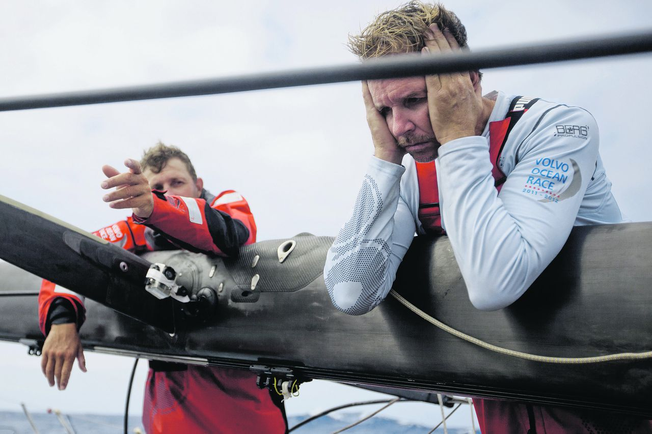 In this photograph supplied by Volvo Ocean Race, PUMA Ocean Racing powered by BERG skipper Ken Read from the USA, (right), reacts to a broken mast on the first leg of the Volvo Ocean Race 2011-12, which began 17 days ago from Alicante, Spain. The rig onboard PUMA's Mar Mostro failed at around 15:00 UTC, Monday, Nov 21, 2011, in the southern Atlantic Ocean, about 2,150 nautical miles from Cape Town, South Africa. None of the crew were hurt and the team have retired from the first leg of the race and are heading towards Tristan da Cunha, less than 700 nautical miles away. (Amory Ross/PUMA Ocean Racing/Volvo Ocean Race photo via AP Images) EDITORIAL USE ONLY