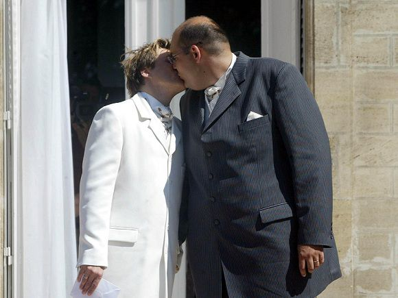 Caption: (FILES) A file picture taken on June 05, 2004 at the city hall of Begles, southwestern France, shows Stephane Chapin (L) and Bertrand Charpentier (R) kissing after their marriage, the first France's gay wedding, a court decision ruled definitively illegal in 2007. French parlimentaries will vote on June 15, 2011 at France's National Assembly on a bill project presented by French opposition parties to allow same-sex wedding. AFP PHOTO MICHEL GANGNE