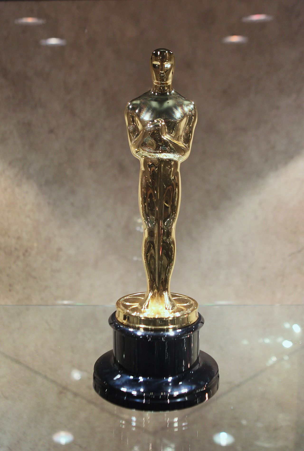 CHICAGO, IL - FEBRUARY 09: An Oscar statuette sits in a display case at R.S. Owens & Company February 9, 2012 in Chicago, Illinois. R.S. Owens manufactures the Oscar statuettes which are presented at the annual Academy Awards by the Academy of Motion Picture Arts and Sciences. After the theft of the statuettes prior to the 2000 Academy Awards the company began casting the statuettes one year in advance of the show. Scott Olson/Getty Images/AFP == FOR NEWSPAPERS, INTERNET, TELCOS & TELEVISION USE ONLY ==