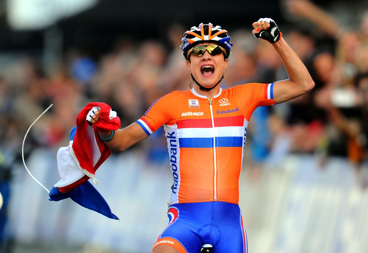 Netherlands' Marianne Vos reacts as she crosses the finish line to win the Women's Elite Road race World Championships on September 22, 2012 in Valkenburg. Vos won ahead of second placed Australia's Rachel Neylan and third placed Italy's Elisa Longo Borghini. AFP PHOTO / FRANCK FIFE