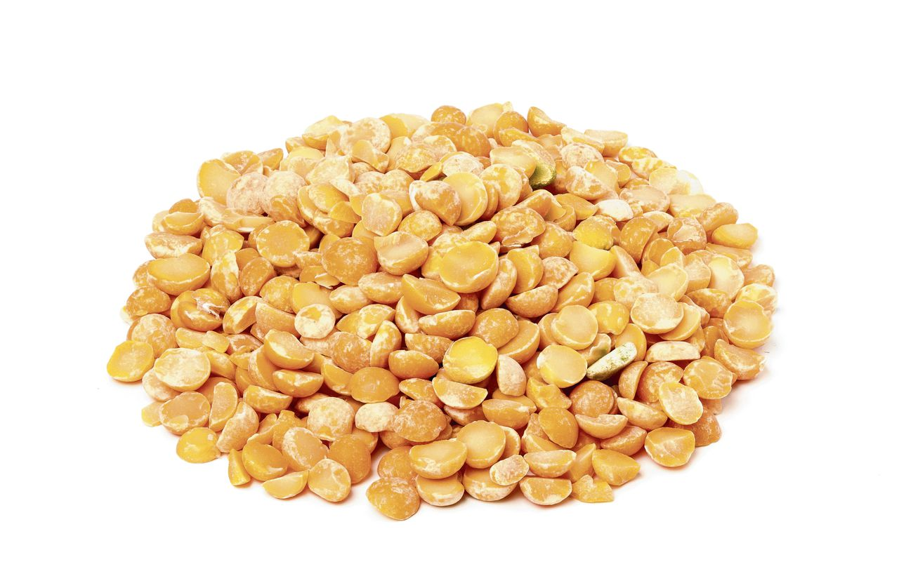 Dry yellow peas isolated on a white background.