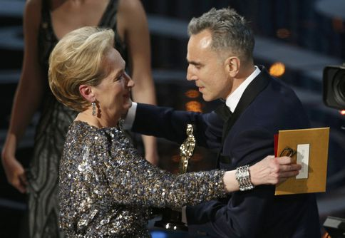 Actress Meryl Streep presents the Oscar for best actor to Daniel Day Lewis for his role in