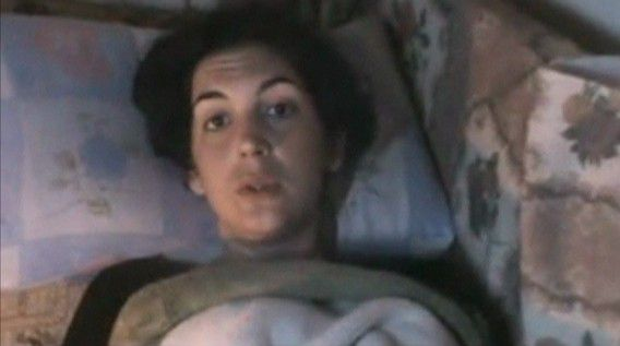 EDITORS' NOTE - REUTERS IS UNABLE TO INDEPENDENTLY CONFIRM THE CONTENTS OF THIS VIDEO, WHICH WAS OBTAINED FROM A SOCIAL MEDIA WEBSITE. Injured French journalist Edith Bouvier speaks to the camera as she lies on a sofa in Homs in this still image taken from a video posted on a social media website on February 23, 2012. Bouvier, in a YouTube clip posted by activists, said she urgently needed an operation on a broken leg and appealed for a ceasefire and medical transport to neighbouring Lebanon. She said she was wounded in the same attack that claimed the lives of Sunday Times correspondent Marie Colvin and French photographer Remi Ochlik on Wednesday. REUTERS/YouTube via Reuters TV (SYRIA - Tags: POLITICS CONFLICT) THIS IMAGE HAS BEEN SUPPLIED BY A THIRD PARTY. IT IS DISTRIBUTED, EXACTLY AS RECEIVED BY REUTERS, AS A SERVICE TO CLIENTS. FOR EDITORIAL USE ONLY. NOT FOR SALE FOR MARKETING OR ADVERTISING CAMPAIGNS