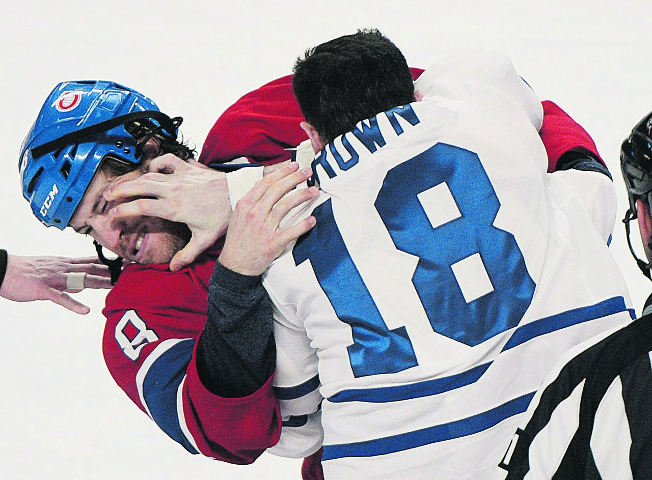 Montreal Canadiens' Brandon Prust (8) fights with Toronto Maple Leafs' Mike Brown during first period of an NHL hockey game in Montreal, Saturday, Jan. 19, 2013. (AP Photo/The Canadian Press, Graham Hughes)