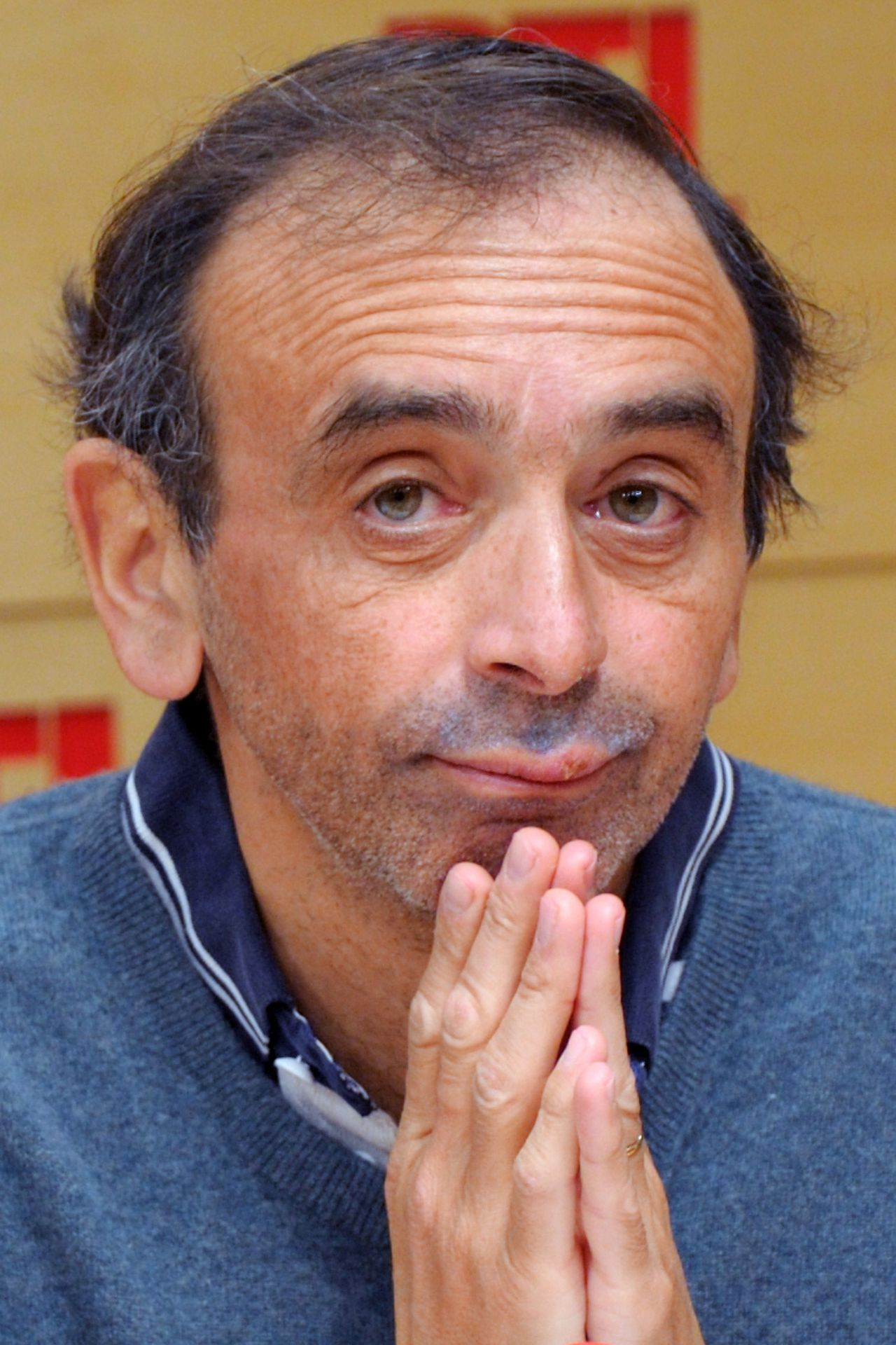 "(FILES) - A file picture taken on February 27, 2012 in Paris, shows French journalist Eric Zemmour during a radio show at the RTL radio station studios. Zemmour is accused on May 28, 2012, by The Movement Against Racism and for Friendship between Peoples (Mrap) and anti-racist organization SOS RACISME for having used on RTL radio ""racist "" and "" male chauvinist"" comments against French Justice Minister, Christiane Taubira. AFP PHOTO / POOL / PHILIPPE WOJAZER"