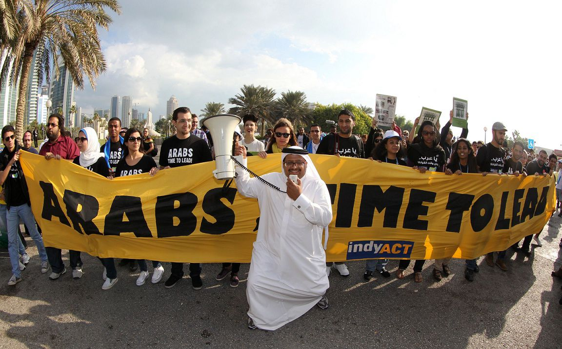 Activists shout slogans and carry placards during a rally in Doha on December 1, 2012 to demand urgent action addressing climate change as the United Nations Convention on Climate Change continues in the Qatari capital. The chances of hitting the UN's global warming target are diminishing, but the goal can still be met if greenhouse-gas emissions fall by 15 percent by 2020, scientists said. AFP PHOTO / AL-WATAN DOHA / KARIM JAAFAR == QATAR OUT ==