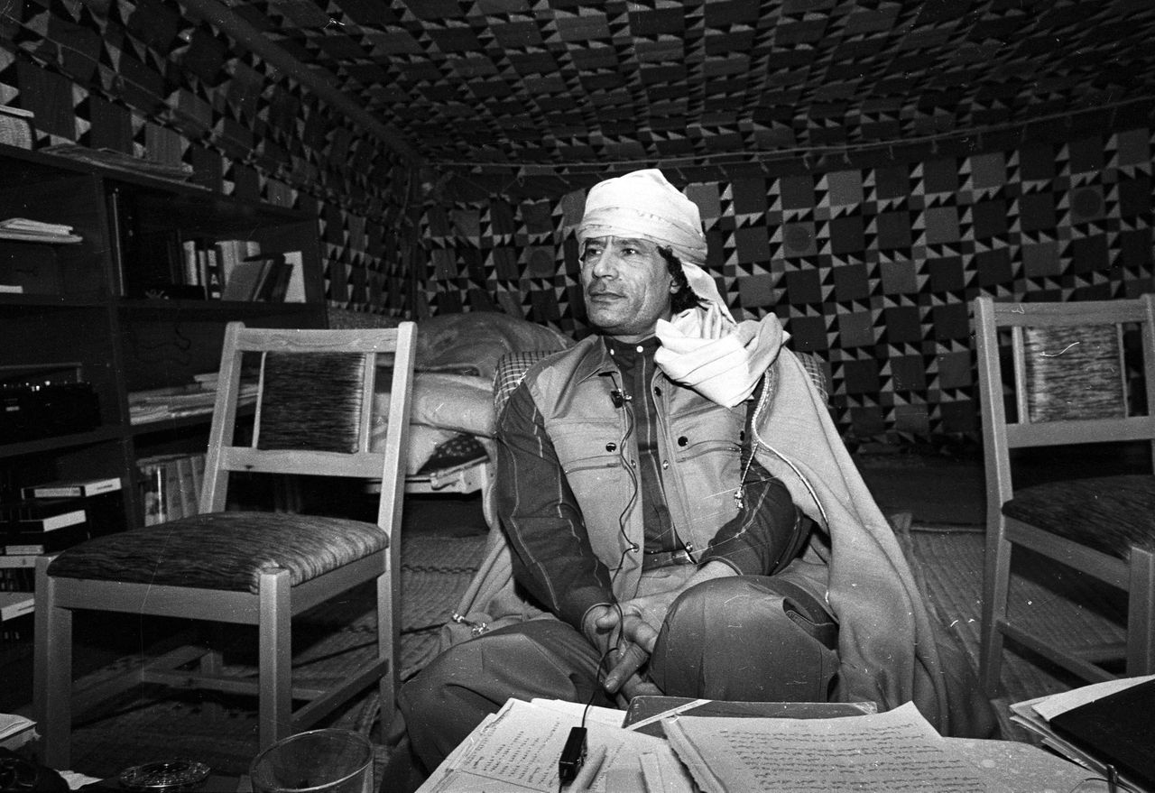 "Libyan leader Muammar Gaddafi looks on during a news conference where he presented his family to U.S. female journalists inside his Bedouin tent erected in the heavily fortified Bab El-Assaria barracks on the outskirts of Tripoli in this January 12, 1986 file photo. A defiant Gaddafi said on February 22, 2011 he was ready to die ""a martyr"" in Libya, vowing to crush a growing revolt which has seen eastern regions break free of his 41-year rule and brought deadly unrest to the capital. REUTERS/Kate Dourian/Files (LIBYA - Tags: POLITICS CIVIL UNREST PROFILE) ) QUALITY FROM SOURCE"