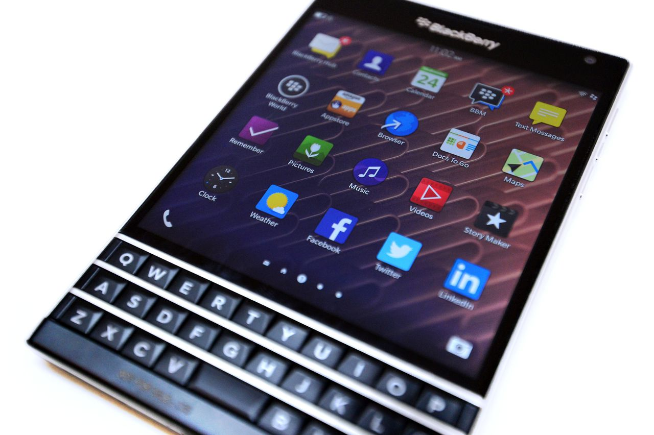 A picture shows a close-up view of the new Blackberry Passport smartphone during at a simultaneous launch event in London on September 24, 2014. BlackBerry on Wednesday unveiled its newest smartphone with a full physical keyboard and a large screen, aiming to return to its roots targeting business users. The BlackBerry Passport, named for its approximate size to the travel document, is designed to win back key corporate users after the struggling Canadian company was effectively knocked out of the highly competitive consumer smartphone market dominated by Apple and Samsung. AFP PHOTO / CARL COURT