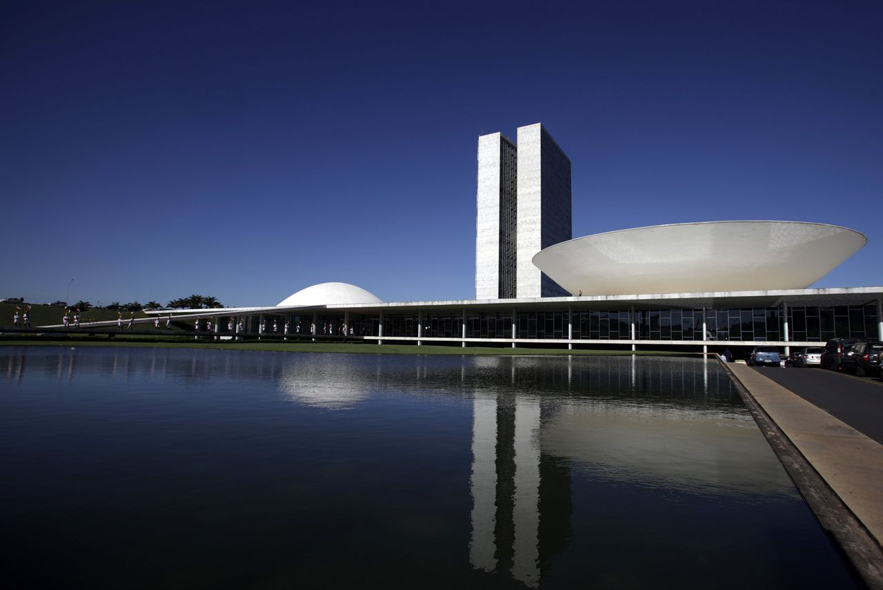 The Brazilian National Congress designed by architect Oscar Niemeyer is seen in Brasilia in this April 7, 2010 file photo. Niemeyer, a towering patriarch of modern architecture who shaped the look of modern Brazil and whose inventive, curved designs left their mark on cities worldwide, died late on December 5, 2012. He was 104. Niemeyer had been battling kidney ailments and pneumonia for nearly a month in a Rio de Janeiro hospital. His death was confirmed by a hospital spokesperson. REUTERS/Ricardo Moraes/Files (BRAZIL - Tags: OBITUARY SOCIETY)