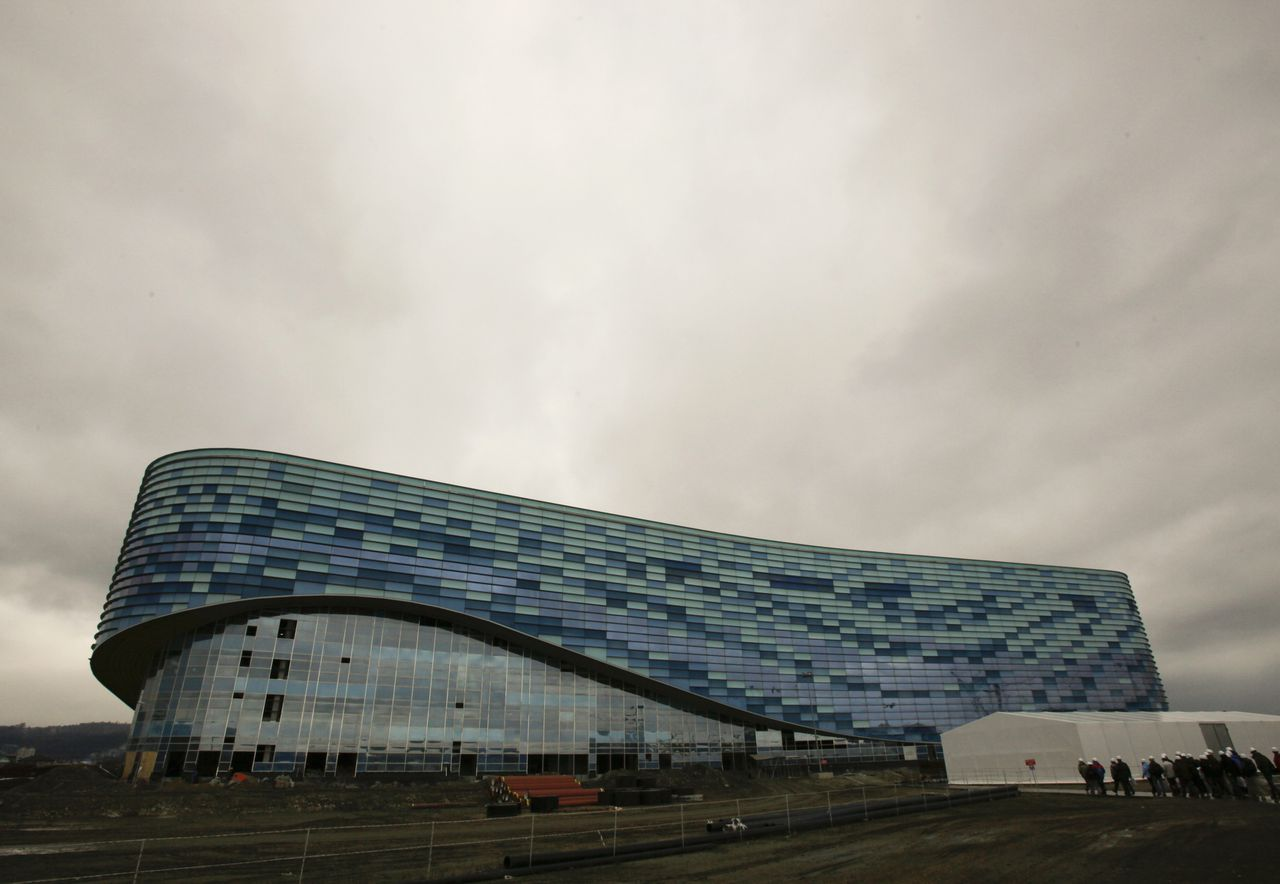 """Rain clouds are seen over the """"Olympic Oval"""" skating centre during an organized tour to the construction sites of the Olympic venues in Sochi February 10, 2012. The """"Olympic Oval"""" will host the speed skating events of the 2014 Olympic and Paralympic Winter Games in the Black Sea resort of Sochi. The stadium with a capacity of 8,000 spectators is expected to be completed in September 2012 and will be used as a trade and exhibition centre after the Games. REUTERS/Wolfgang Rattay (RUSSIA - Tags: SPORT BUSINESS CONSTRUCTION OLYMPICS ENVIRONMENT)"""
