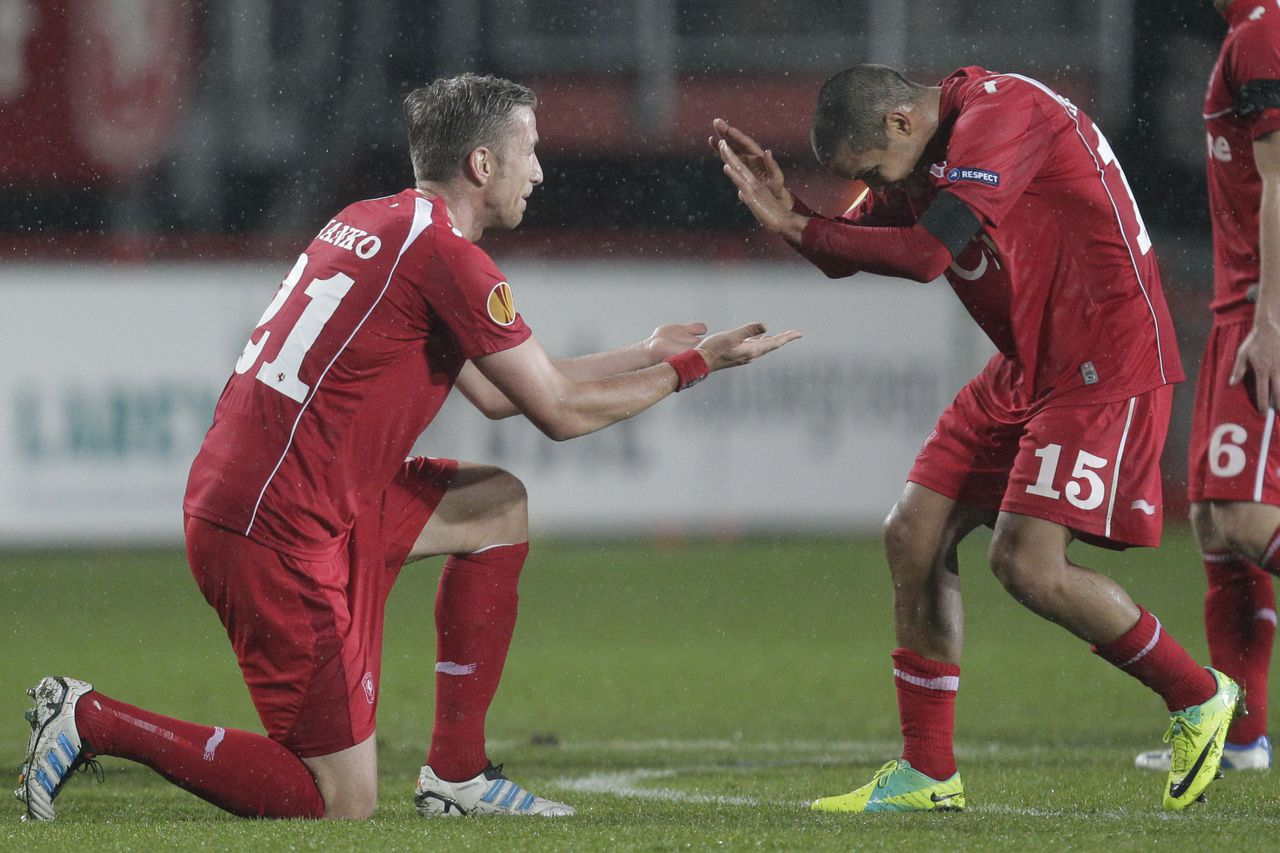 Twente players Roberto Rosales, who gave the pass, and Marc Janko, left, who scored 1-0, celebrate at the end of the match against Fulham during the group K Europa League soccer match in Enschede, eastern Netherlands, Thursday Dec. 1, 2011. (AP Photo/Peter Dejong)
