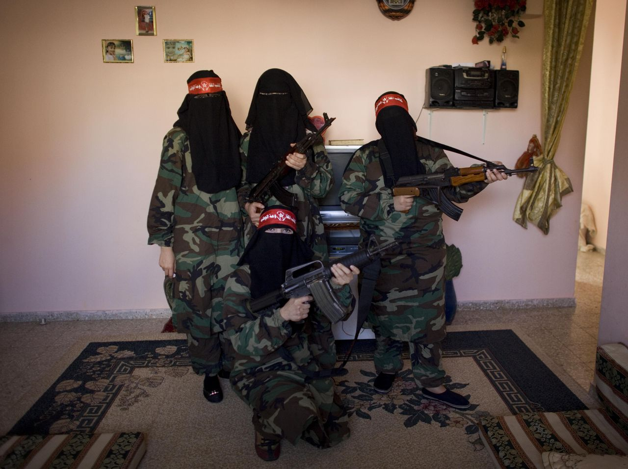 Naveen, left, Shareen, right, Wafaah, center, and Omm Ahmed, women militants for the Democratic Front for the Liberation of Palestine (DFLP), pose for a portrait in a house of a fellow fighter, in the Gaza Strip, Thursday, Nov. 12, 2009. Founded in 1969 the DFLP is a Palestinian Marxist-Leninist, secular political and military organization. Approximately 40 women militants for the DFLP started training 6 months ago as a response to Israel's January offensive. They range in age from 17 to 53 and many are married with children. (AP Photo/ Tara Todras-Whitehill