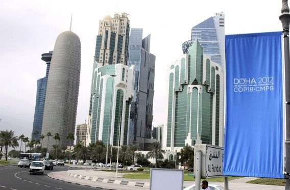 FILE - In this Wednesday, Nov. 20, 2012 file photo, conference flags are displayed ahead of the Doha Climate Change Conference, in Doha, Qatar, Wednesday, Nov. 20, 2012. The eighteenth session of the Conference of the Parties (COP 18) will take place from Monday, Nov. 26 to Friday, Dec. 6, 2012.(AP Photo/Osama Faisal, File)