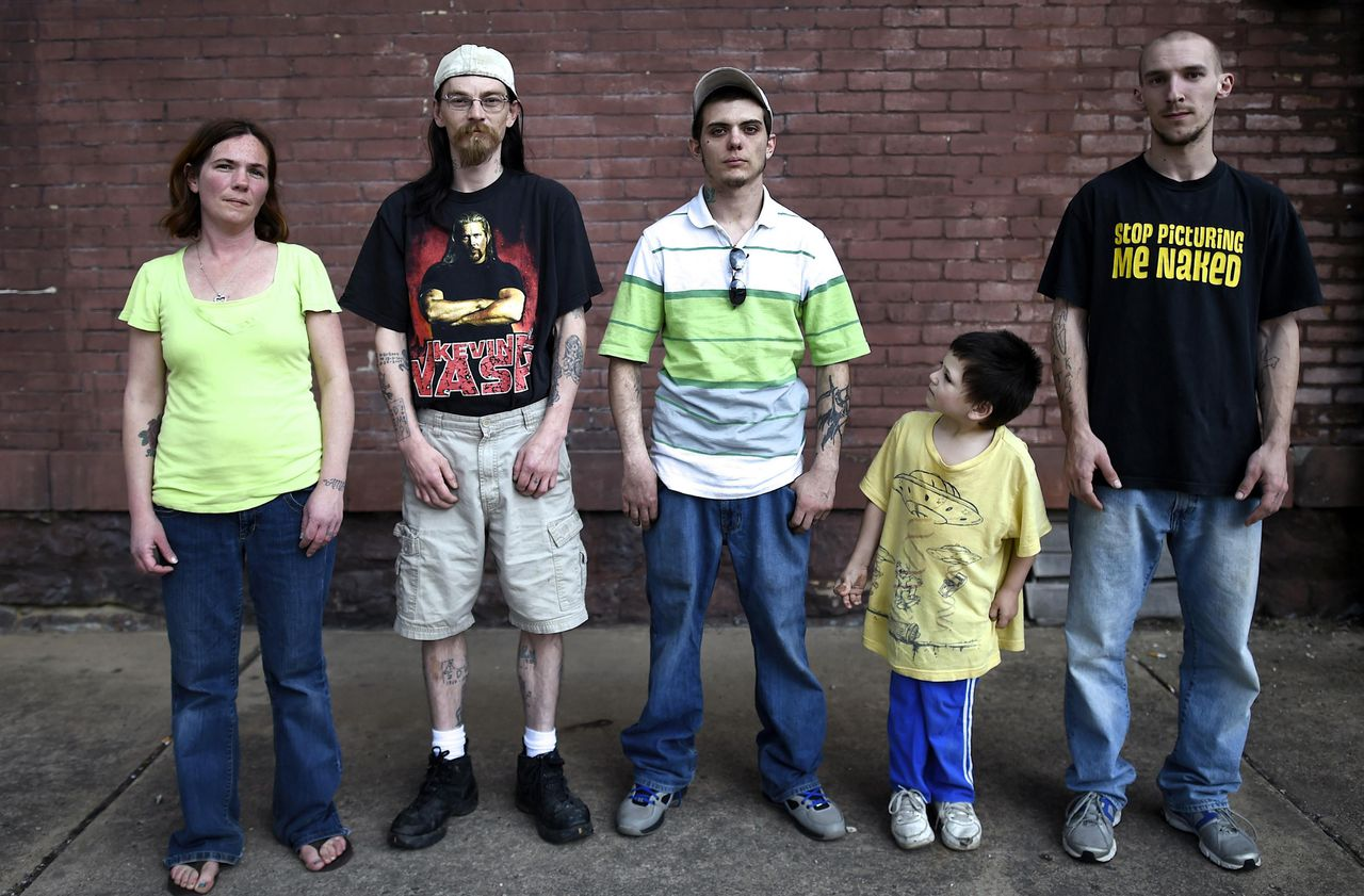 Shamokin's residents (L to R) Jessica Kruleski, 33, Traci Carmen, 34, Gary Parks, 27, Anson Barrett, 5, and Jeff Try, 22, pose for a picture on the street in Shamokin May 1, 2014. Shamokin, Pennsylvania, tucked away in the coal country about 120 miles northwest of Philadelphia, has $800,000 of unpaid bills and can't get a loan from a bank. It is so broke, the gas service to city hall was temporarily cut off last month. So the council for the city of 7,000 residents has agreed to seek entry to a state financial oversight program dating from 1987 that facilitates access to credit and permits the levying of certain taxes. Picture taken May 1, 2014. To match Story USA-PENNSYLVANIA/MUNICIPALS REUTERS/Mark Makela (UNITED STATES - Tags: BUSINESS POLITICS SOCIETY)