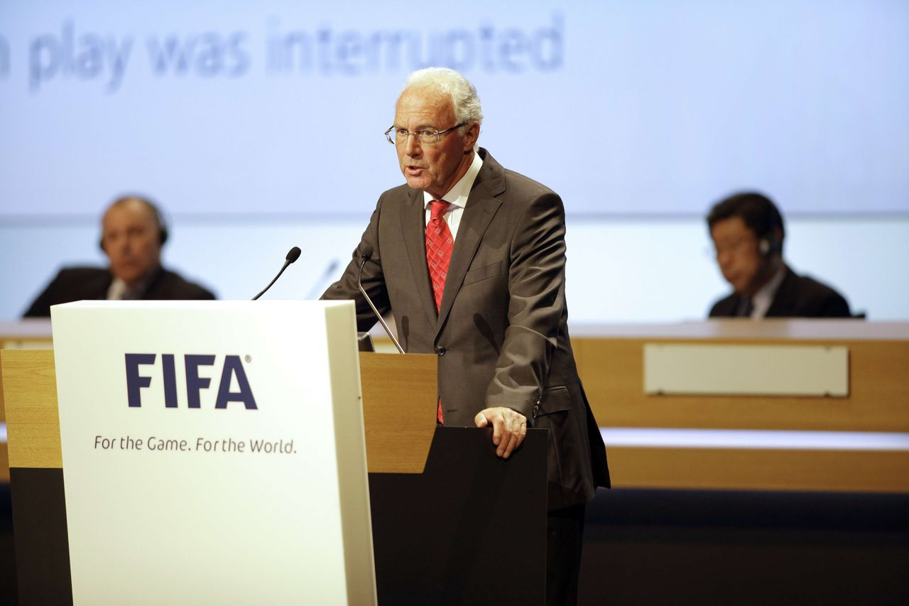 German football legend Franz Beckenbauer addresses a speech at the Hungexpo of Budapest on May 25 , 2012 during the 62nd FIFA Congress meeting. AFP PHOTO / PETER KOHALMI
