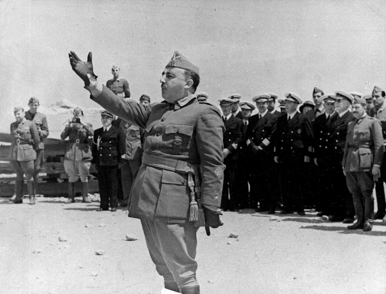 ** TO MATCH STORY SLUGGED SPAIN-FRANCO ANNIVERSARY ** General Francisco Franco speaks to naval forces at Vinaroz, Spain, on July 26, 1938, en route to the front to supervise the drive against the Republican Army at Valencia. This Sunday, Nov. 20 sees the 30th anniversary of the death of Gen. Francisco Franco, the man who rebelled against Spain's young republic in 1936, starting a civil war which ushered in his nearly 40-year rule, iron-fisted and often brutal. Two days later comes the 30th anniversary of the proclamation as king of Spain of Juan Carlos, the person who, although hand-picked as Franco's successor, has played the most important role in the country's transition to democracy and is seen as the single most important unifying factor in Spain. (AP Photo/AP Photo)