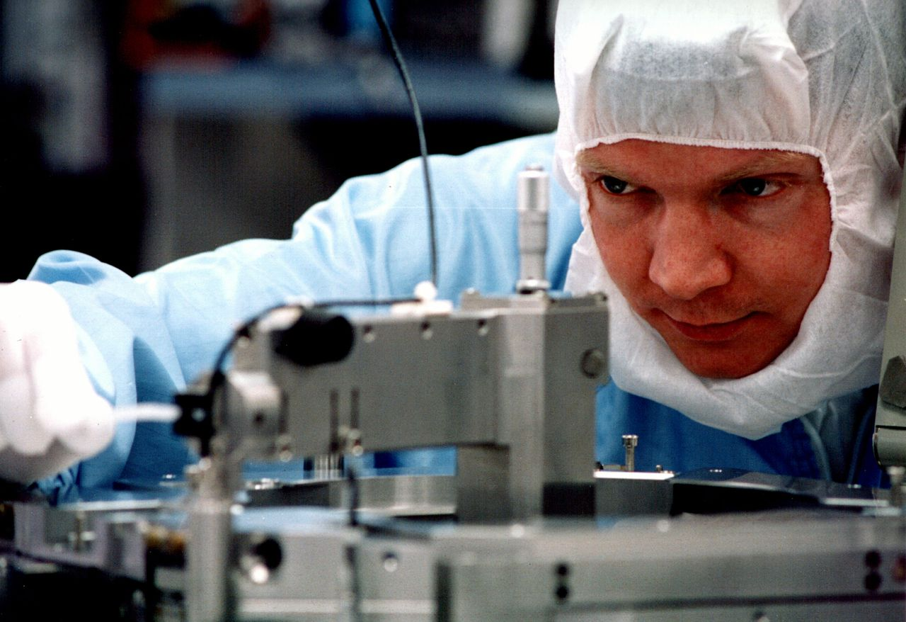 This is an undated company photograph, released to the media on Oct. 18, 2006, of a technician working in an ASML Holdings NV plant. ASML Holding NV, Europe's largest maker of semiconductor equipment, said orders rose for the first time in four quarters, rebounding after a two-year low, as chipmakers planned increased production. Source: ASML Holding NV via Bloomberg News