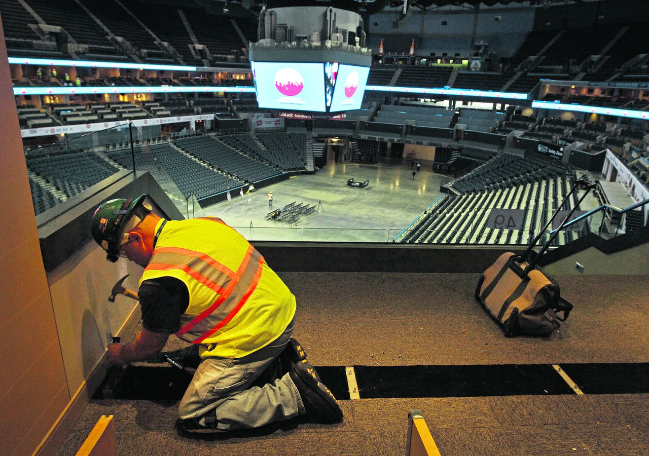 Steve Law, with Mazor Construction, works on a luxury box at Time Warner Cable Arena as the Democratic National Convention Committee officially moved into the building where it will hold the majority of their convention, in Charlotte, N.C., Monday, July 16, 2012. (AP Photo/Chuck Burton)