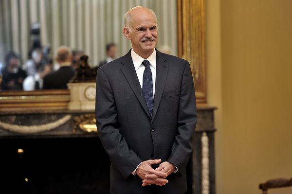 Greek Prime Minister George Papandreou smiles during a swearing in ceremony of his newly appointed ministers , at the Presidential palace in Athens on June 17, 2011. Embattled Greek Prime Minister George Papandreou axed his finance minister, naming a former foe to implement deeply unpopular austerity measures and ward off economic meltdown. AFP PHOTO / LOUISA GOULIAMAKI