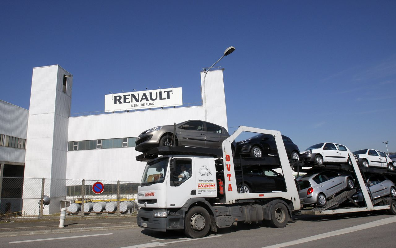 FILE - In this March 20, 2009 file photo, a car carrier transporting Renault cars is seen at the Flins Renault plant in Aubergenville, west of Paris. Car makers Renault SA and PSA Peugeot Citroen SA saw sales surge in November, as car buying picked up in their home market, France, by 48 percent.(AP Photo/Christophe Ena, file)