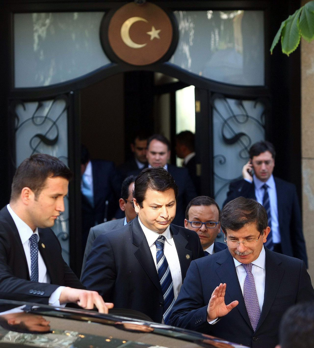 TOPSHOTS Turkey's Foreign Minister Ahmet Davutoglu (R) leaves a meeting to discuss efforts to locate the crew and future steps, with army generals and other officials, in Ankara, on June 23, 2012 after Syria confirmed it had shot down a Turkish fighter jet. Turkey said on June 23 one of its fighter jets may have violated Syrian airspace after Damascus confirmed shooting it down, in comments seen as a bid to cool the latest spat between the former allies. Both countries were now searching for the two missing crew of the Turkish F-4 Phantom jet shot down over the eastern Mediterranean on June 22, 2012.AFP PHOTO/ADEM ALTAN
