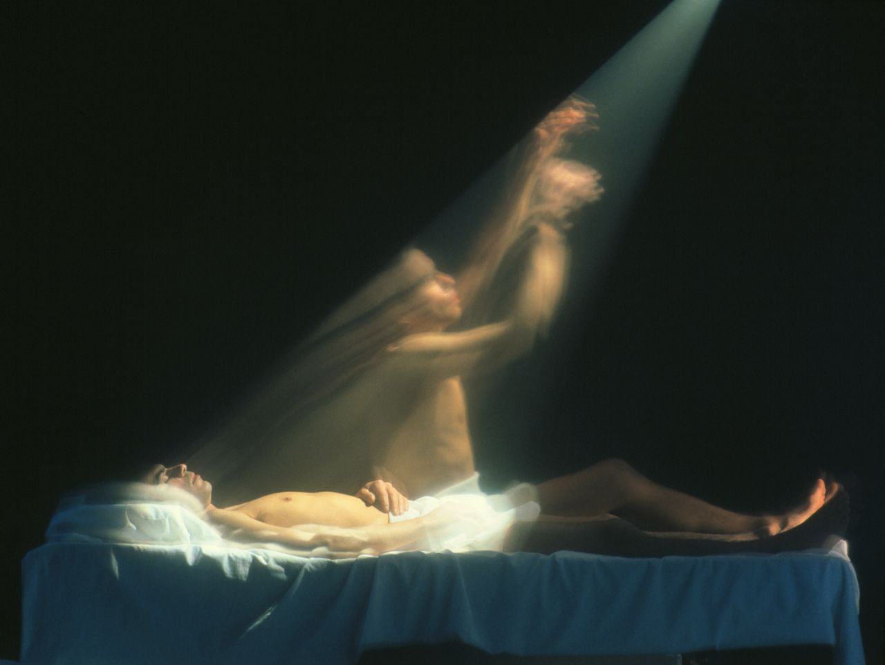 MODEL RELEASED. Abstract illustration of transfiguration, showing the ghostly form of a person departing his body.
