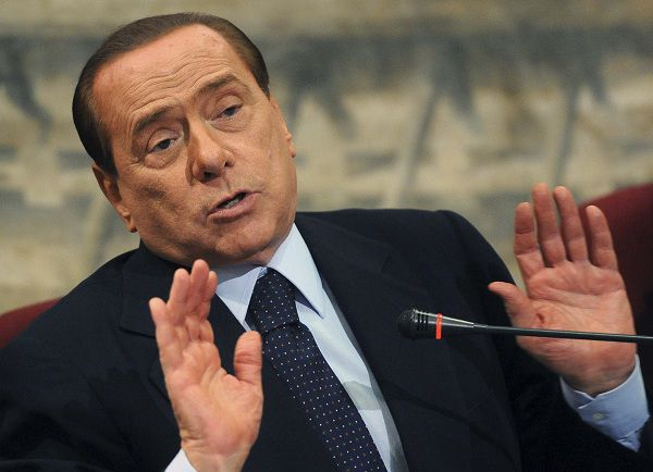 Italian Prime Minister Silvio Berlusconi gestures during a presentation of a book by Italian member of Parliament Domenico Scilipoti at Montecitorio Palace in Rome July 7, 2011. REUTERS/Stringer (ITALY - Tags: POLITICS)