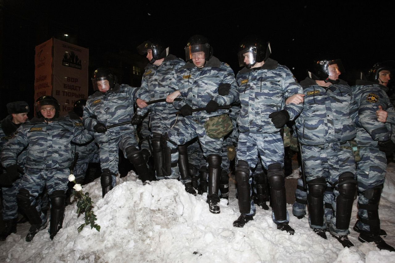 Riot police form a line during a protest by opponents of Vladimir Putin, Russia's prime minister, in Moscow, Russia, on Monday, March 5, 2012. Thousands of protesters rallied in central Moscow's Pushkin Square the day after Putin claimed victory in a presidential election that international observers said was unfair. Photographer: Alexander Zemlianichenko Jr./Bloomberg