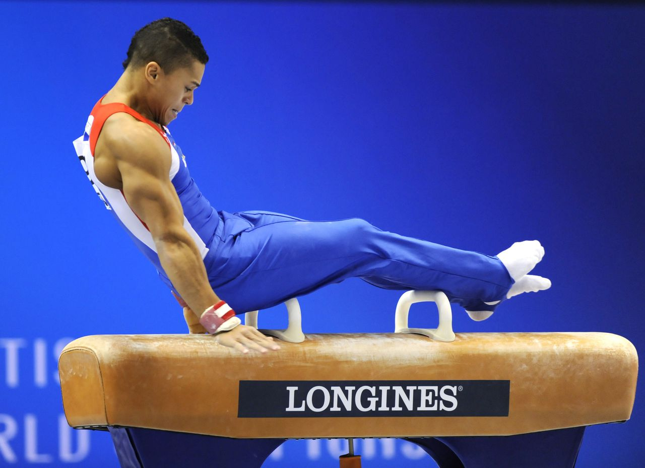 Jeffrey Wammes of the Netherlands performs on the pommel horse during men's qualification at the world gymnastics championships in Tokyo on October 9, 2011. The top eight men's teams will advance to the finals and earn berths in next year's London Olympics. AFP PHOTO/KAZUHIRO NOGI