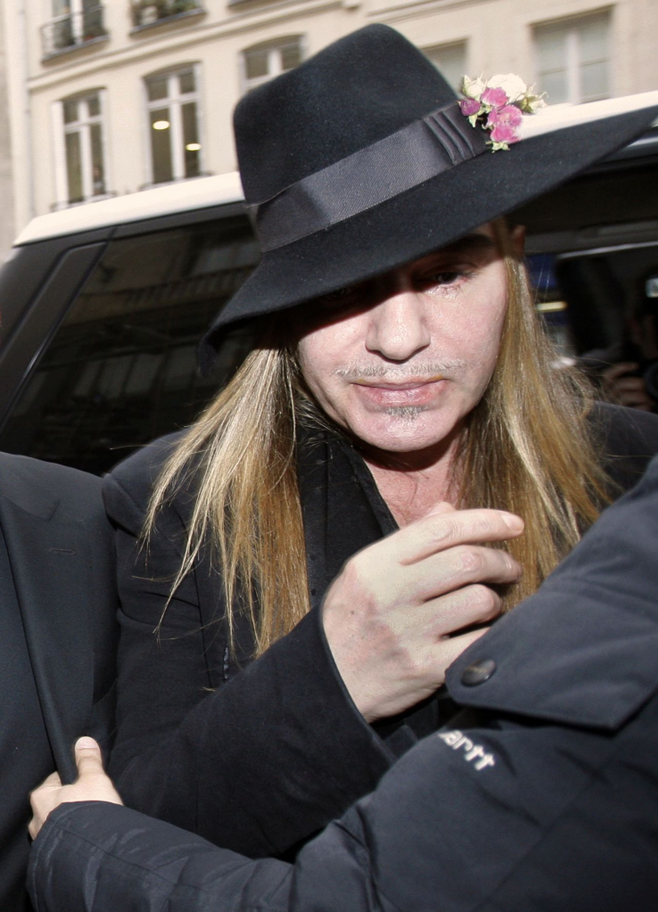 FILE - In this Feb. 28, 2011 file photo, fashion designer John Galliano arrives at a police station in Paris. A Paris court on Thursday, Sept. 8, 2011 convicted former Christian Dior designer John Galliano for making anti-Semitic insults and gave him a suspended sentence of euro 6,000 ($8,400) in fines. (AP Photo/Michel Euler, File)