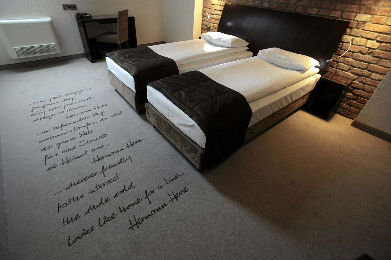 A view shows a room at the Remes hotel in Opalenica, west of Poznan, November 24, 2011. The hotel was chosen by Portugal's soccer team to act as their hub for the Euro 2012 soccer championships. Picture taken November 24, 2011. REUTERS/Piotr Skornicki/Agencja Gazeta (POLAND - Tags: SPORT SOCCER TRAVEL) (EURO 2012 Team Hotel) FOR EDITORIAL USE ONLY. NOT FOR SALE FOR MARKETING OR ADVERTISING CAMPAIGNS. THIS IMAGE HAS BEEN SUPPLIED BY A THIRD PARTY. IT IS DISTRIBUTED, EXACTLY AS RECEIVED BY REUTERS, AS A SERVICE TO CLIENTS. POLAND OUT. NO COMMERCIAL OR EDITORIAL SALES IN POLAND