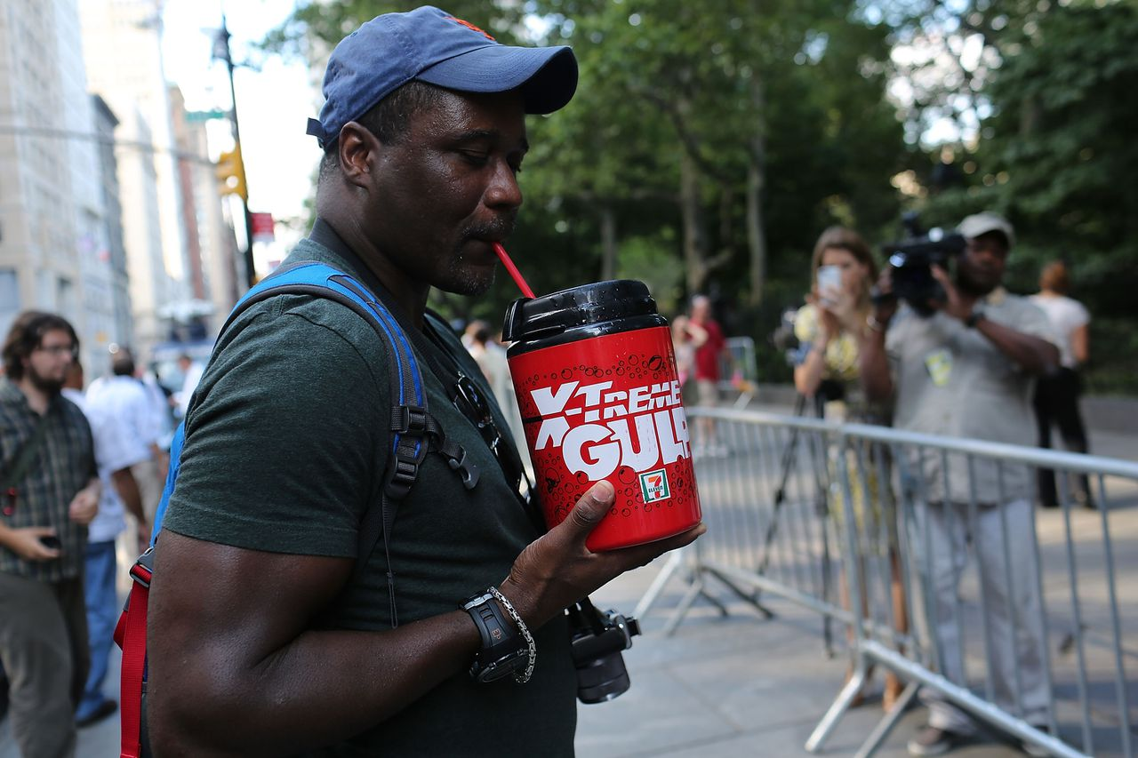 "NEW YORK, NY - JULY 09: Eric Moore attends a protest billed as the `'Million Big Gulp March"" in lower Manhattan which is opposed to Mayor Michael Bloomberg's proposal to prohibit licensed food service establishments from using containers larger than 16 ounces on July 9, 2012 in New York City. In an attempt by the administration to fight obesity, New York City Mayor Michael Bloomberg announced plans recently to implement a ban on the sale of large sodas and other sugary drinks at restaurants, movie theaters and street carts. The ban has proved controversial with many people saying it will not decrease obesity and will be a further erosion of personal choice. Spencer Platt/Getty Images/AFP == FOR NEWSPAPERS, INTERNET, TELCOS & TELEVISION USE ONLY =="