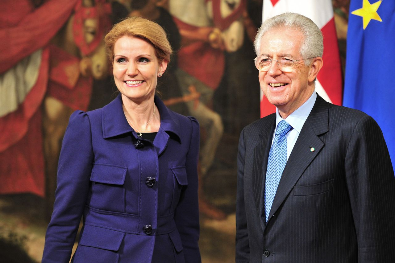 Italy's Prime Minister Mario Monti (R) greets his Danish counterpart Helle Thorning Schmidt during a meeting on December 12, 2011 at Palazzo Chigi, Italy's prime Ministry, in Rome. AFP PHOTO / ALBERTO PIZZOLI