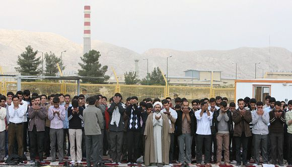 Caption: A group of Iranian students pray in front of the Isfahan Uranium Conversion Facility during a gathering in support of Iran's nuclear program, just outside the city of Isfahan, 410 kilometers, 255 miles south of the capital Tehran, Iran, Tuesday, Nov. 15, 2011. (AP Photo/Vahid Salemi)