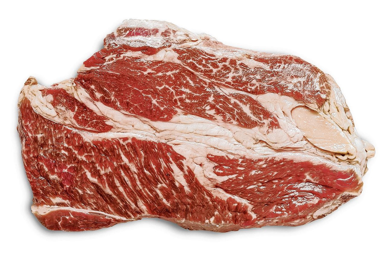 close up of uncooked wagyu beef steak isolated